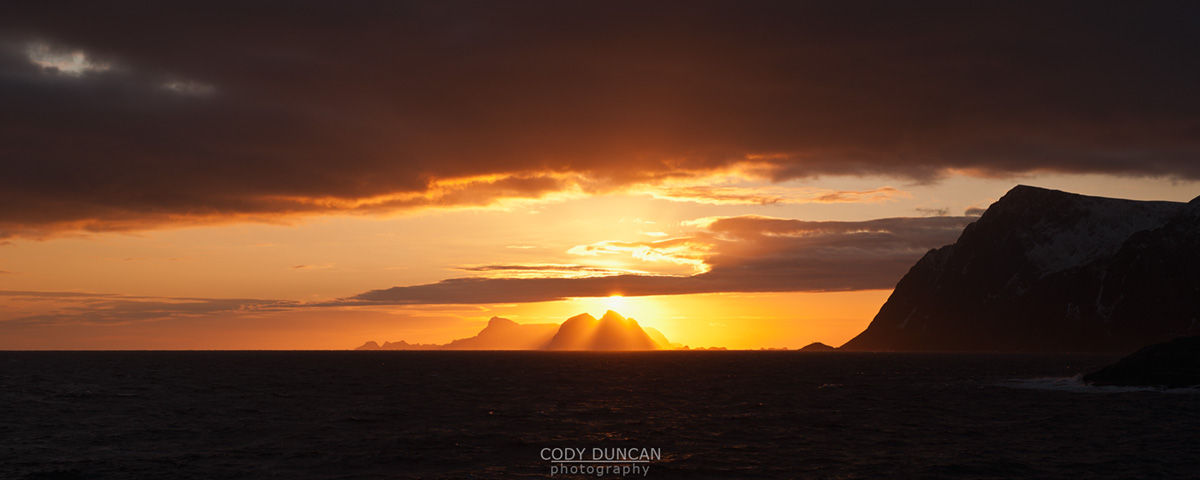 Winter sun sets over Væerøy island viewed from near Ņ, Lofoten Islands, Norway