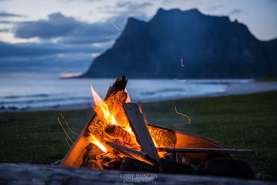 Evening campfire at Utakleiv beach, Lofoten Islands, Norway