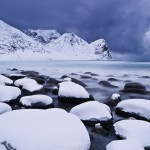 Winter storm over snow covered beach, Unstad, Lofoten islands, Norway