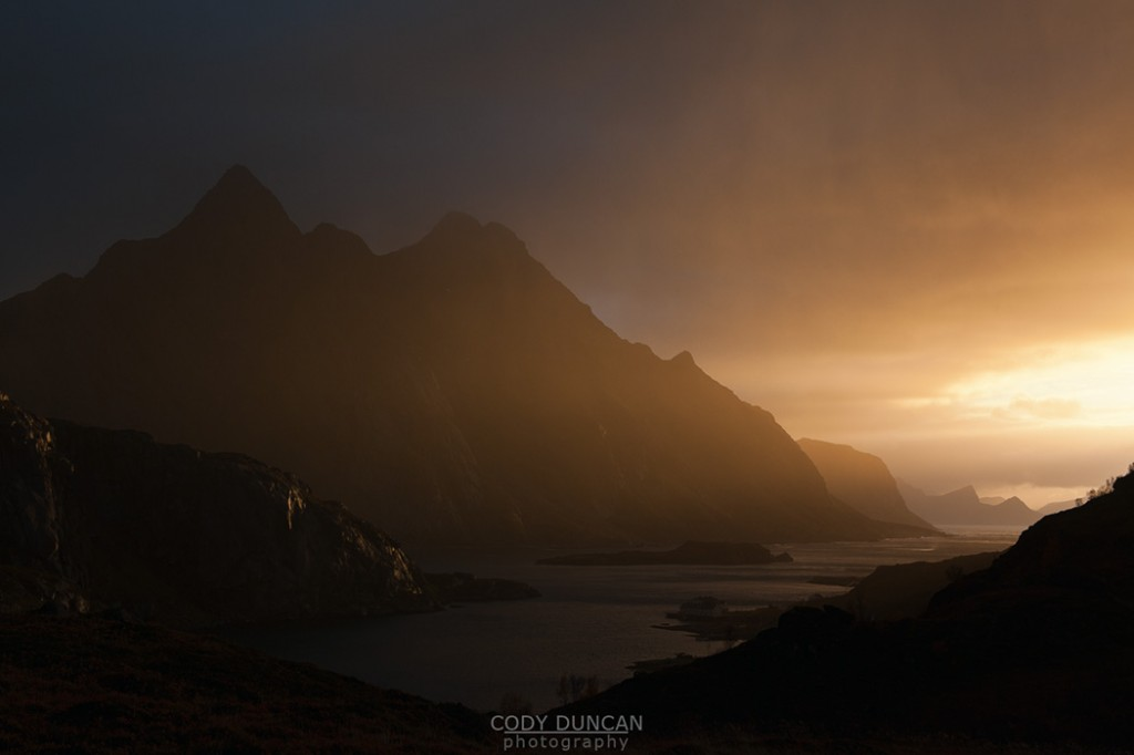 Dramatic light over mountains and coast, Maervoll, Lofoten islands, Norway