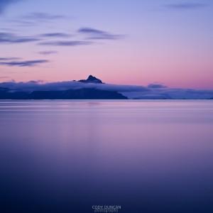 Vågakallen mountain peak rises from sea above Henningsvaer, Norway