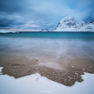 Sea and snow meet at Vik Beach, Vik, Vestvågøy, Lofoten Islands, Norway