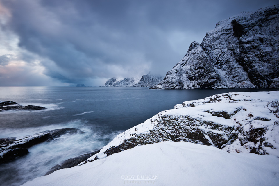 Dramatic scenery at snow covered coastline, Å I Lofoten, Lofoten Islands, Norway