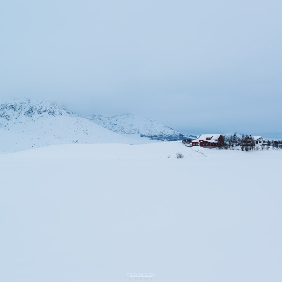 Farm building in snowy winter landscape, Farstad, Vestvågøy, Lofoten Islands, Norway