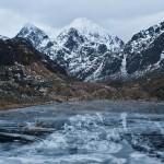 Mountain reflection of frozen lake Vikvatnet, Vestvagoy, Lofoten Islands, Norway