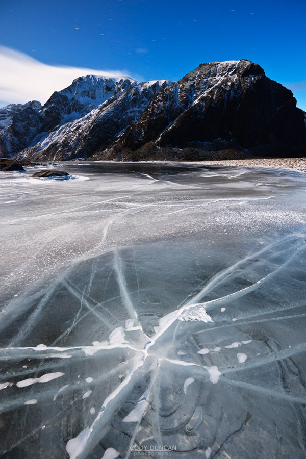 Night image of crack in frozen lake Nedre Heimdalsvatnet, Eggum, Lofoten Islands, Norway
