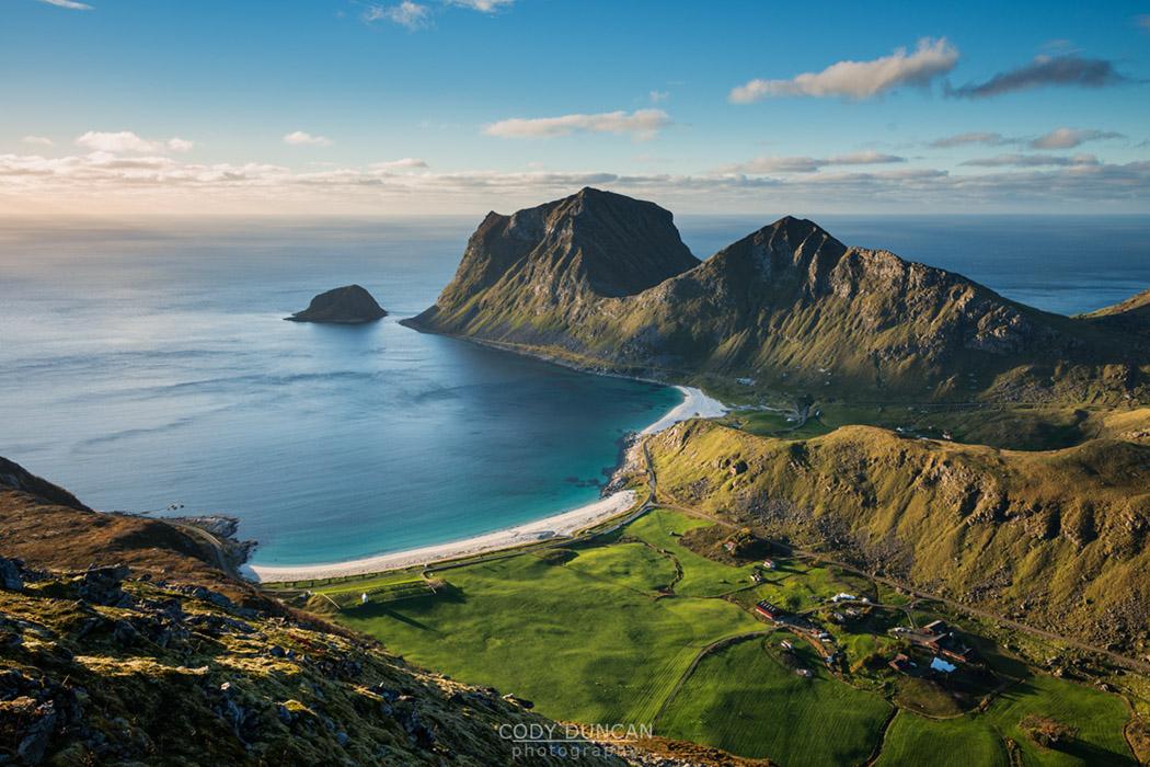 View of Vik and Haukland beaches from summit of Holandsmelen mountain peak, Vestvagoy, Lofoten Islands, Norway