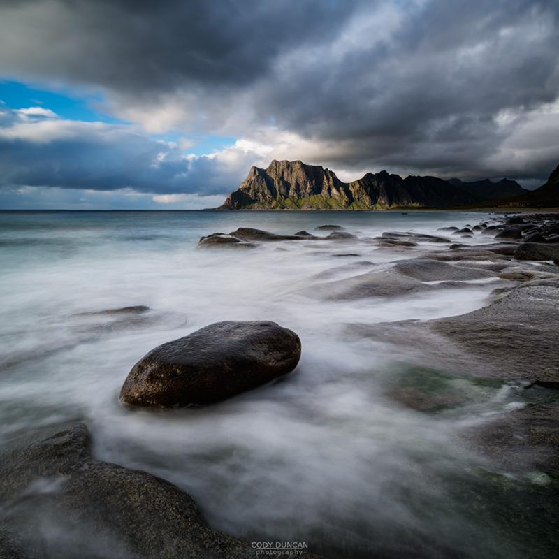 Waves break across rocky coastline at Unstad beach, Vestvagoy, Lofoten Islands, Norway