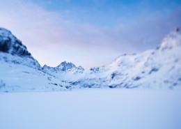 Lake Ågvatnet and snow covered mountain landscape, Å I Lofoten, Lofoten islands, Norway