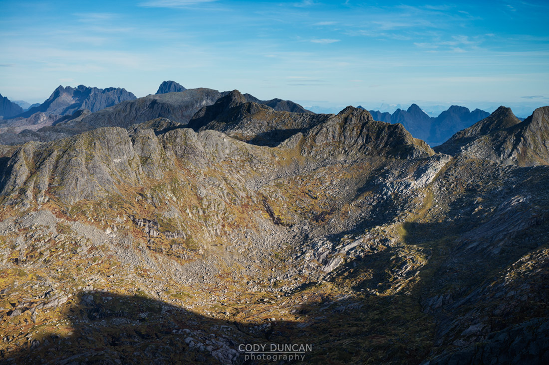 Rugged mountain landscape viewed from summit of Kroktind (707m), Austvagoy, Lofoten Islands, Norway