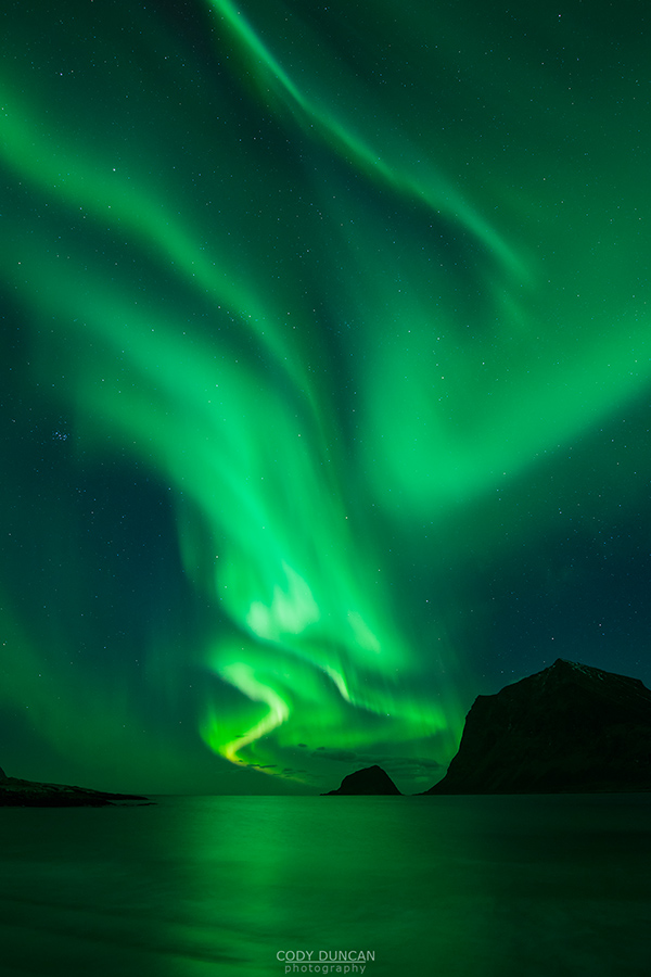 Northern Lights over Vik beach, Lofoten Islands, Norway