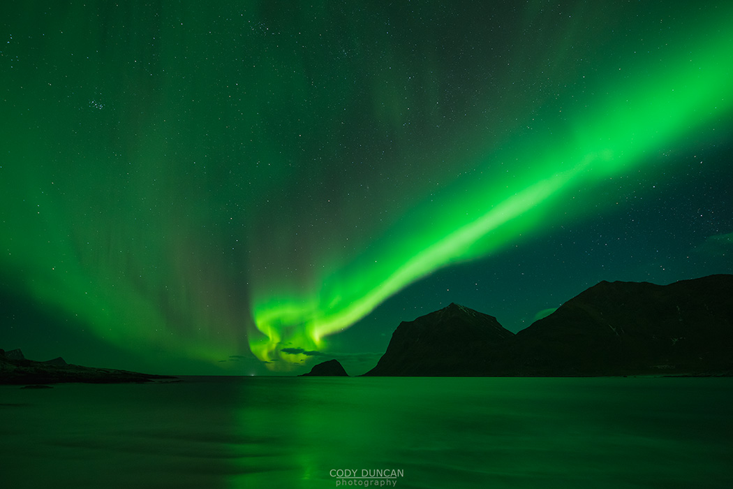 Northern Lights - Aurora Borealis shine in Sky over Vik Beach, Vestvågøy, Lofoten Islands, Norway