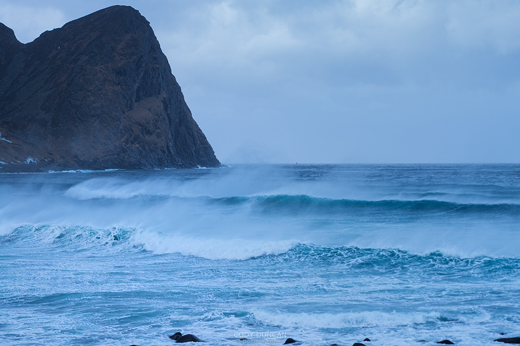 Offshore wind blows waves at Unstad beach, Vestvågøy, Lofoten Islands, Norway