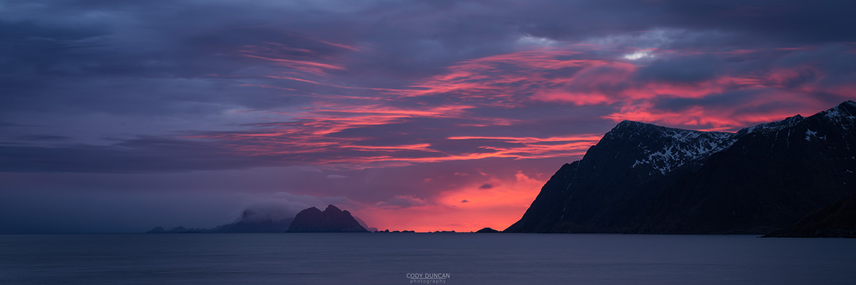 Pink clouds at sunset over Værøy islands from near Å I Lofoten, Moskenesøy, Lofoten Islands, Norway