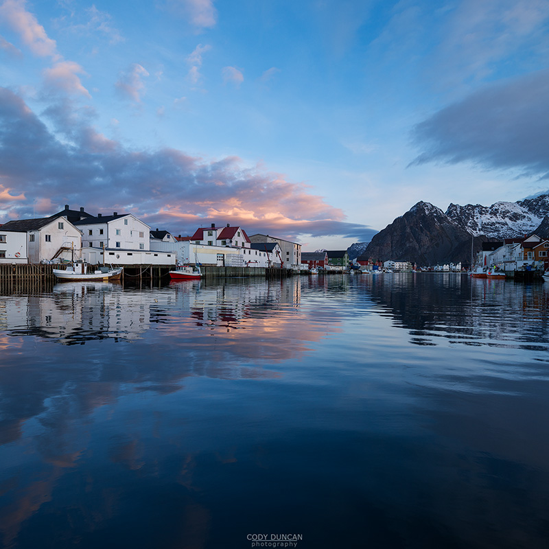 Mountain reflection in Harbour at scenic fishing village of Henningsvær, Austvågøy, Lofoten Islands, Norway