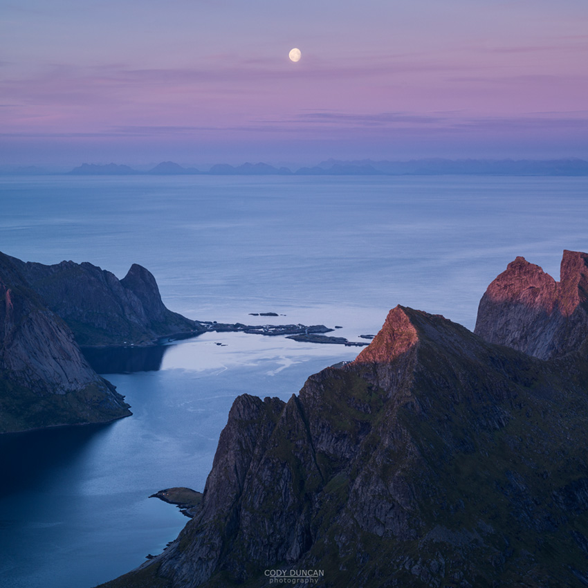 Moon rises over Vestfjord and Moskenesoy from summit of Hermannsdalstind, Lofoten Islands, Norway