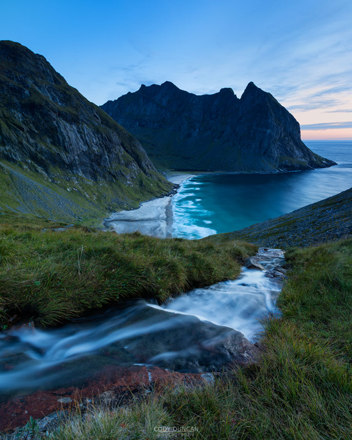 View of river flowing towards Kvalvika beach, Moskenesøy, Lofoten Islands, Norway