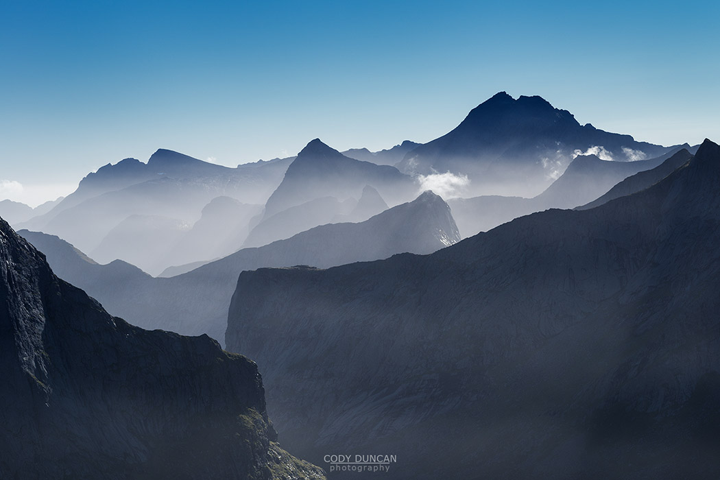 VIew across rugged mountain peaks from the summit of Branntuva (702m); Moskenesøy; Lofoten Islands; Norway