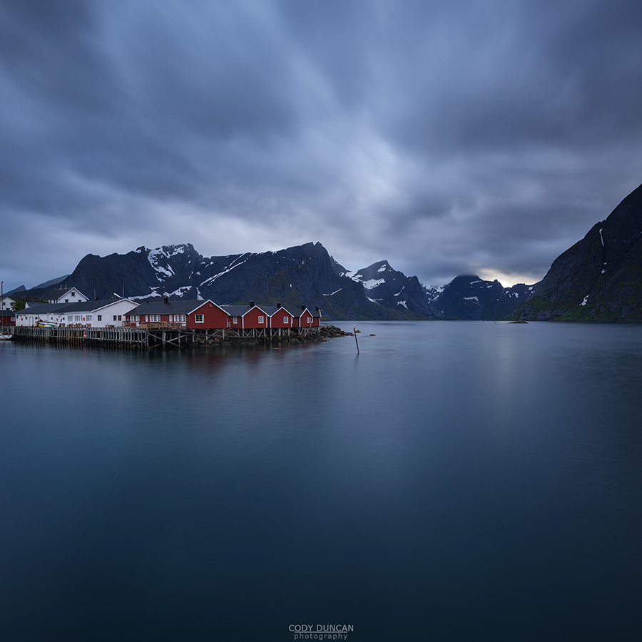 Red fishermen's Rorbu cabins over fjord, Hamnøy, Reine, Moskenesøy, Lofoten Islands, Norway
