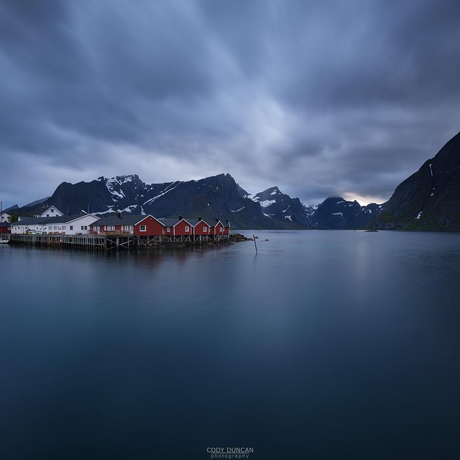 Red fishermen's Rorbu cabins over fjord, Hamnøy, Reine, Moskenesøy, Lofoten Islands, Norway