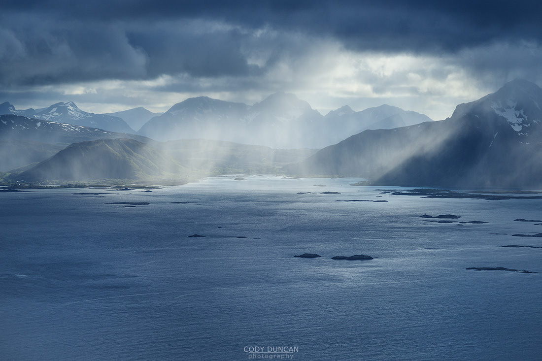 Summer snow flurries approach over sea, Austvågøy, Lofoten Islands, Norway