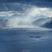 Summer snow flurries approach over sea, Austvågøy, Lofoten Islands, Norway
