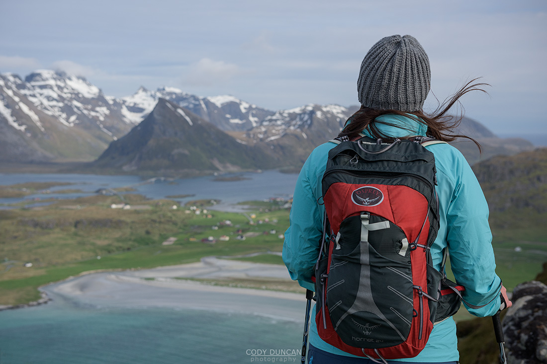 Hiker with over Yttersand beach, Moskenesøy, Lofoten Islands, Norway
