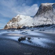 Frozen sand of Bunes beach in winter, Moskenesøy, Lofoten Islands, Norway