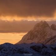 Winter sunrise over Solbjørn mountain peak, Moskenesøy, Lofoten Islands, Norway