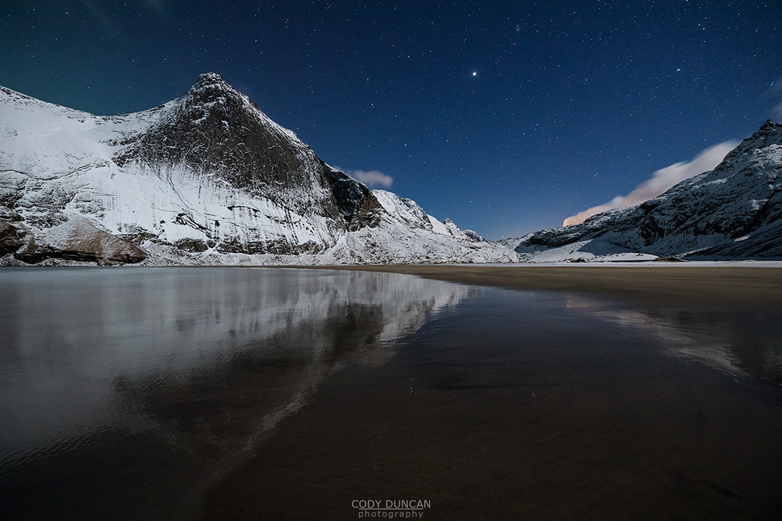 Night winter mountain reflection on Bunes beach, Moskenesøy, Lofoten Islands, Norway