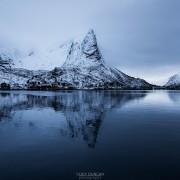 Hammarskaftet mountain peak reflecting in Reine harbor, Moskenesøy, Lofoten Islands, Norway