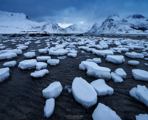 Lofoten Islands, Norway: Remaining snow at low tide in Flakstadpollen. Friday Photo #212 - 68 North. Lofoten Islands Photography and Travel
